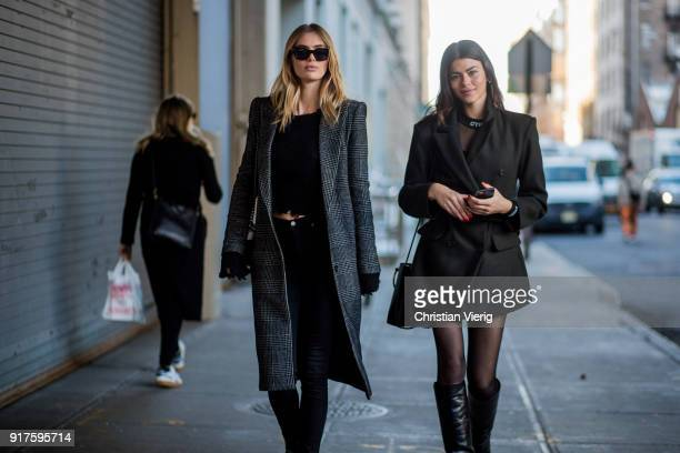 Megan Williams and Georgia Fowler wearing green belted wool coat sheer tights overknees seen outside Zadig Voltaire on February 12 2018 in New York...