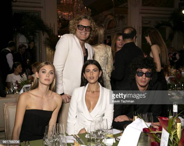 Megan Williams Peter Dundas Georgia Fowler and Julian Perretta attend the amfAR Paris Dinner at The Peninsula Hotel on July 4 2018 in Paris France