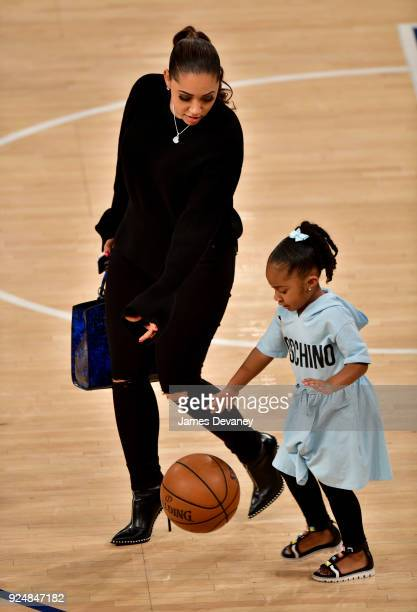 Megan Wollover and Maven Morgan attend the New York Knicks Vs Golden State Warriors game at Madison Square Garden on February 26 2018 in New York City