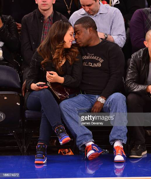 Megan Wollover and Tracy Morgan attend the Houston Rockets vs New York Knicks game at Madison Square Garden on November 14, 2013 in New York City.