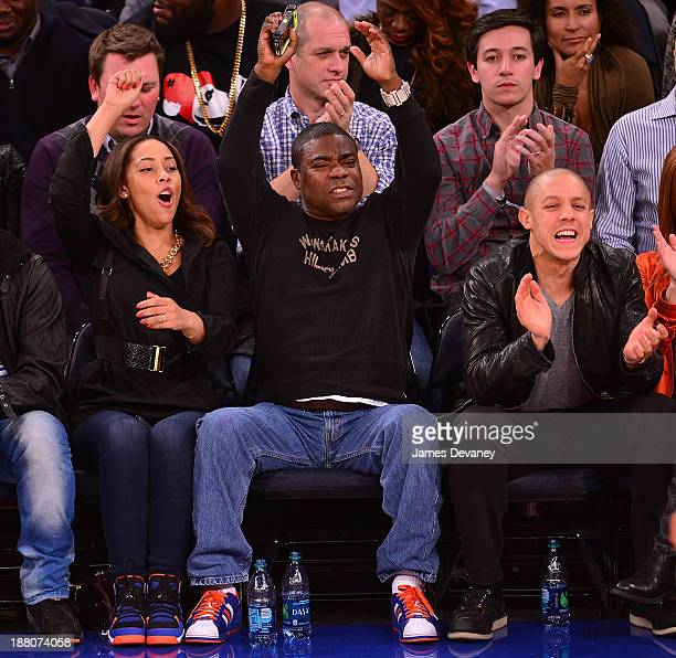 Megan Wollover, Tracy Morgan and Theo Rossi attend the Houston Rockets vs New York Knicks game at Madison Square Garden on November 14, 2013 in New...