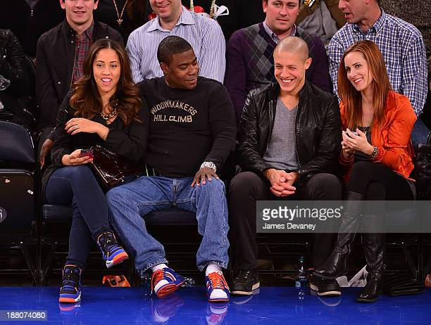 Megan Wollover, Tracy Morgan, Theo Rossi and guest attend the Houston Rockets vs New York Knicks game at Madison Square Garden on November 14, 2013...