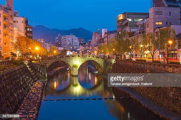 megane bridge at night in nagasaki, japan. - nagasaki prefecture stock pictures, royalty-free photos & images