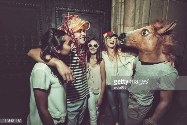 megaparty: friends party wild in the streets - bizarre stock pictures, royalty-free photos & images