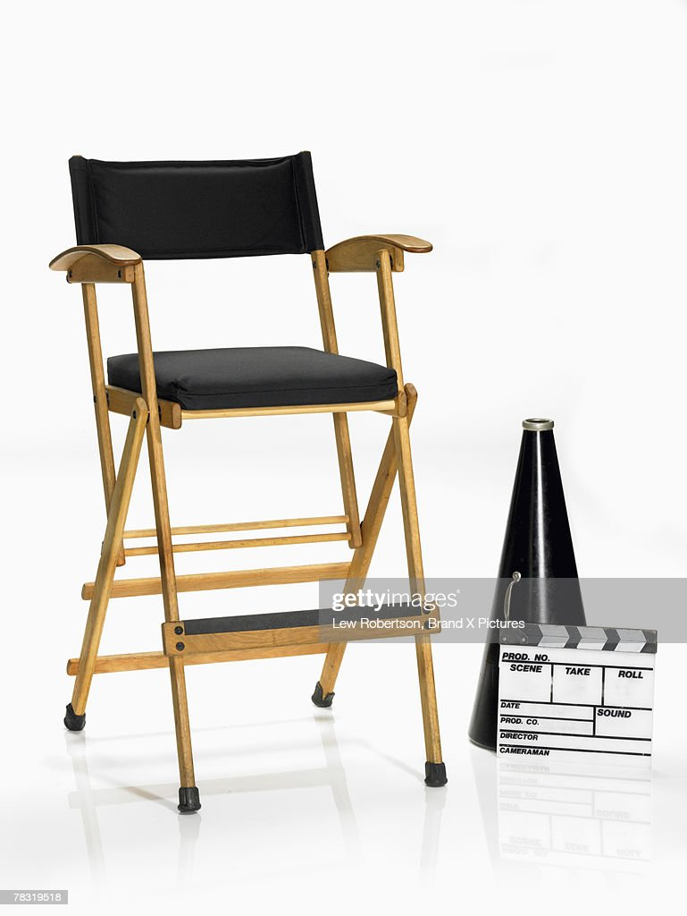 Megaphone and movie slate by directors chair : Stock Photo