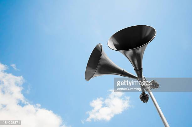 Megaphone loudspeakers standing high up in the air