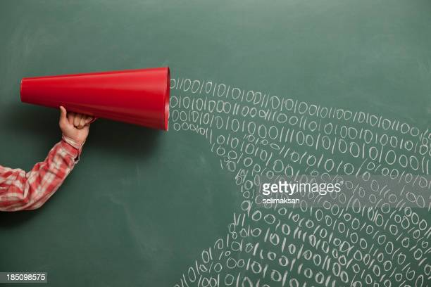 Megaphone with a chalkboard making noise for communication.