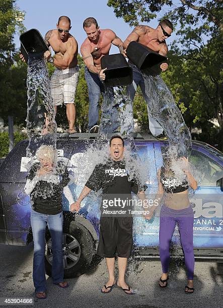 MegaTV on air personalities Charytin Goyco Alex Otaola and Danella Urbay participate in the ALS Ice Bucket Challenge at MegaTV studios on August 20...