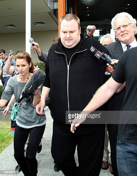 Megaupload boss Kim Dotcom leaves court after he was granted bail in the North Shore court in Auckland on February 22 2012 The 38yearold German...
