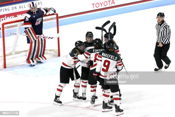 Meghan Agosta of Canada celebrates with Jennifer Wakefield MariePhilip Poulin Laura Fortino and Lauriane Rougeau after scoring a goal against the...