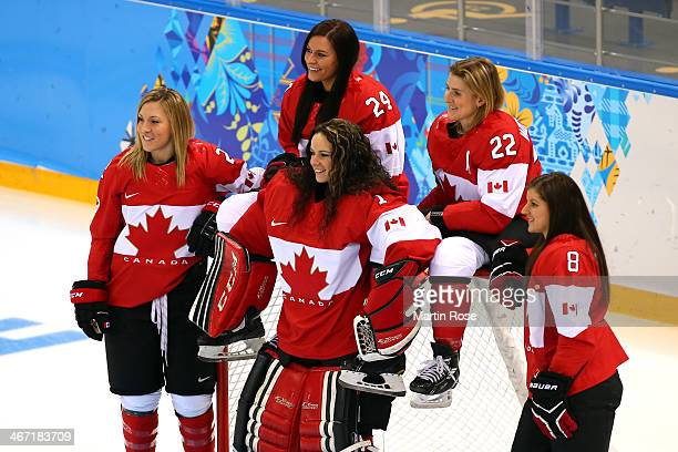 Meghan AgostaMarciano Natalie Spooner Shannon Szabados Hayley Wickenheiser and Laura Fortino of Canada pose for photo on the ice prior to their...