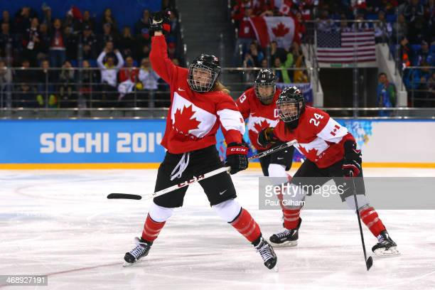 Meghan AgostaMarciano of Canada celebrates after scoring a goal with Natalie Spooner and Caroline Oullette in the third period against the United...