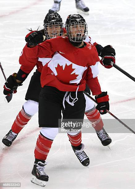 Meghan AgostaMarciano of Canada celebrates after scoring a goal with Natalie Spooner in the third period against the United States during the Women's...