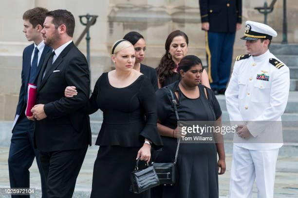 Meghan Bridget second from right and Jack McCain children of the late Sen John McCain RAriz watch an Honor Guard carry his casket out of the...