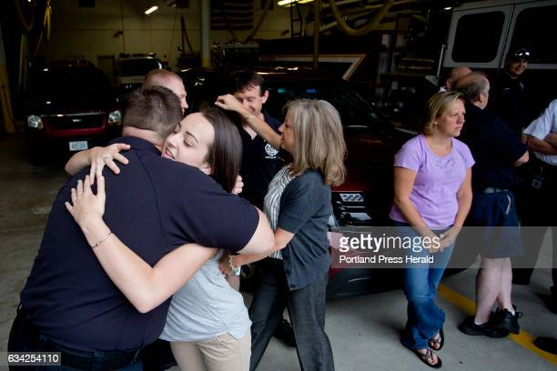 Meghan Dadiego of Westbrook foreground hugs firefighter/paramedic Aaron Riley as her mother Missy Dadiego background goes to hug...