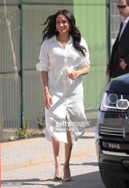 Meghan, Duchess of Sussex accompanied by Prince Harry, Duke of Sussex visit the Tembisa Township to learn about Youth Employment Services during...