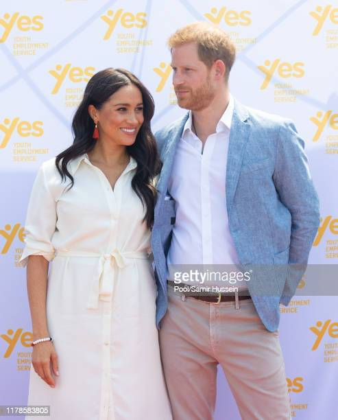 Meghan Duchess of Sussex accompanied by Prince Harry Duke of Sussex visit the Tembisa Township to learn about Youth Employment Services during their...
