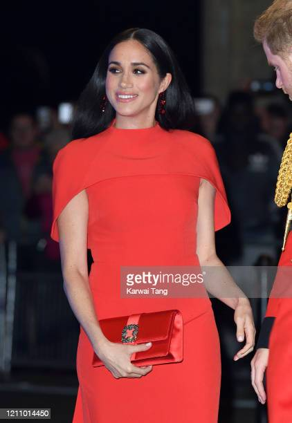 Meghan, Duchess of Sussex accompanied by Prince Harry, Duke of Sussex attends the Mountbatten Festival of Music at Royal Albert Hall on March 07,...