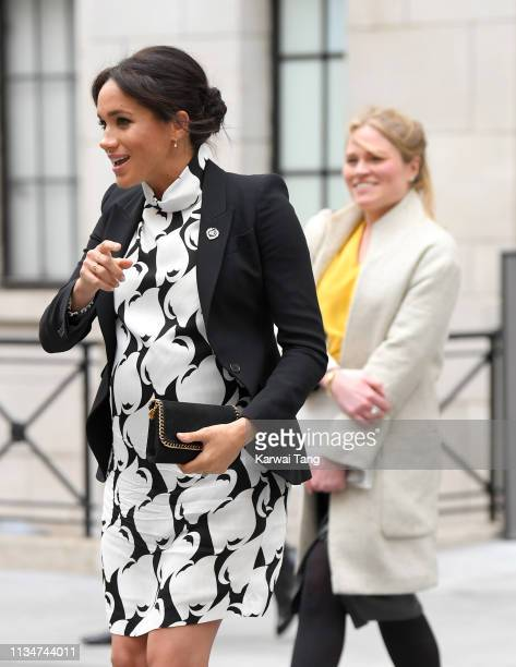 Meghan Duchess of Sussex and Amy Pickerill depart after joining a panel discussion convened by The Queen's Commonwealth Trust to mark International...