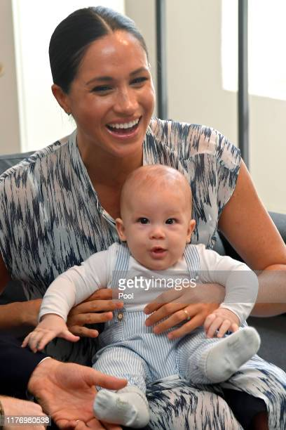 Meghan, Duchess of Sussex and baby son Archie Mountbatten-Windsor meet Archbishop Desmond Tutu and his daughter Thandeka Tutu-Gxashe at the Desmond &...