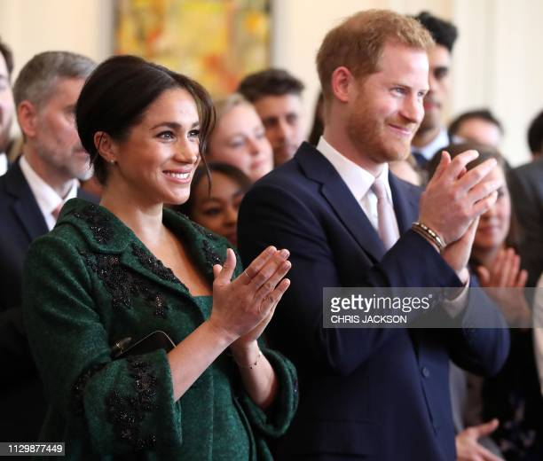 Meghan Duchess of Sussex and Britain's Prince Harry Duke of Sussex watch a musical performance at Canada House the offices of the High Commision of...