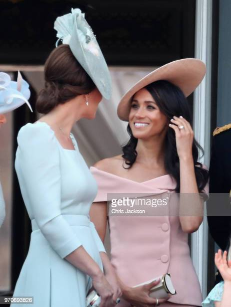 Meghan Duchess of Sussex and Catherine Duchess of Cambridge watch the flypast on the balcony of Buckingham Palace during Trooping The Colour on June...