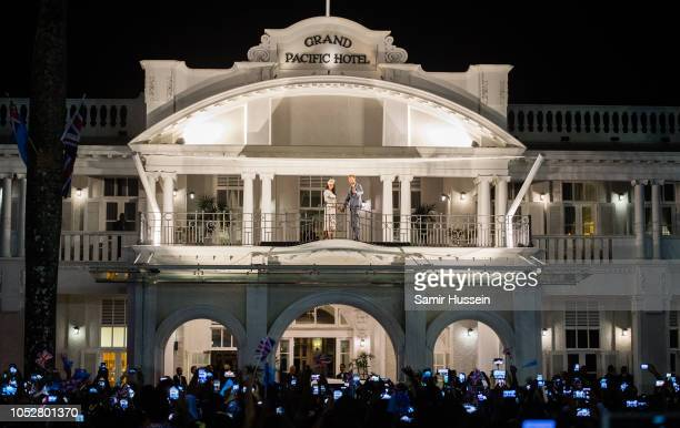 Meghan Duchess of Sussex and Prince Harry Duke of Sussex acknowledge the the public gathered around Albert Park from the balcony of the Grand Pacific...