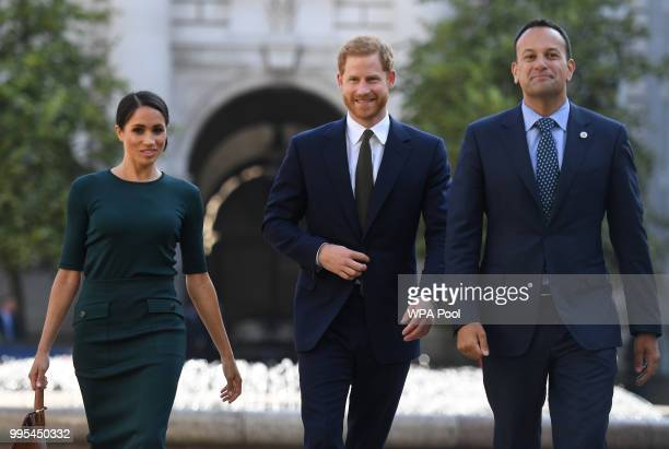 Meghan Duchess of Sussex and Prince Harry Duke of Sussex are greeted by the Taoiseach of Ireland Leo Varadkar as they arrive at the start of a twoday...