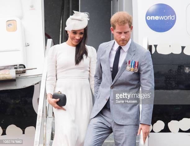 Meghan Duchess of Sussex and Prince Harry Duke of Sussex arrive at Nausori Airport on October 23 2018 in Suva Fiji The Duke and Duchess of Sussex are...