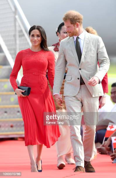 Meghan, Duchess of Sussex and Prince Harry, Duke of Sussex arrive at Fua'amotu Airport on October 25, 2018 in Nuku'alofa, Tonga. The Duke and Duchess...