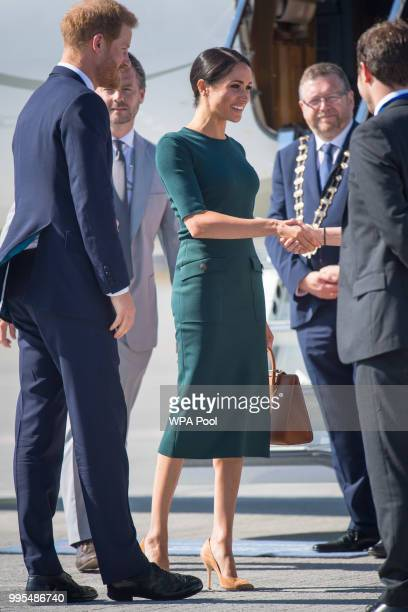 Meghan Duchess of Sussex and Prince Harry Duke of Sussex arrive at the airport for their visit to Ireland on July 10 2018 in Dublin Ireland