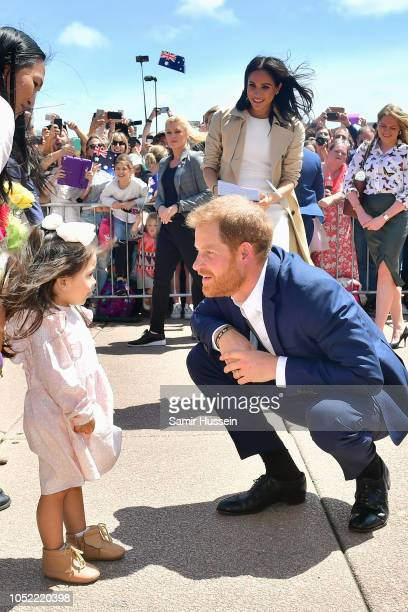 Meghan Duchess of Sussex and Prince Harry Duke of Sussex arrive for a Public Walkabout at the Sydney Opera House on October 16 2018 in Sydney...