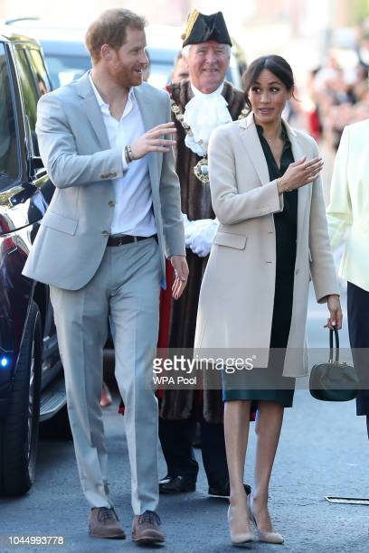 Meghan Duchess of Sussex and Prince Harry Duke of Sussex arrive for an engagement at Edes House during an official visit to Sussex on October 3 2018...