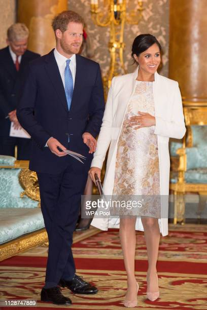 Meghan, Duchess of Sussex and Prince Harry, Duke of Sussex attend a reception to mark the fiftieth anniversary of the investiture of the Prince of...