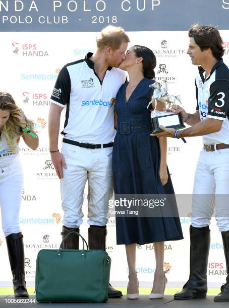 Meghan, Duchess of Sussex and Prince Harry, Duke of Sussex attend the Sentebale ISPS Handa Polo Cup at the Royal County of Berkshire Polo Club on...