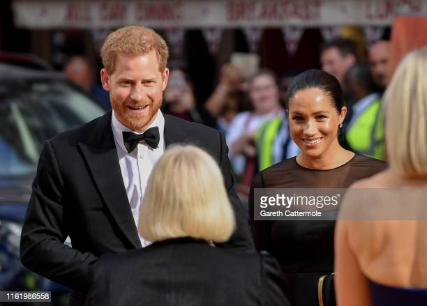 """Meghan, Duchess of Sussex and Prince Harry, Duke of Sussex attend the European Premiere of Disney's """"The Lion King"""" at Odeon Luxe Leicester Square on..."""