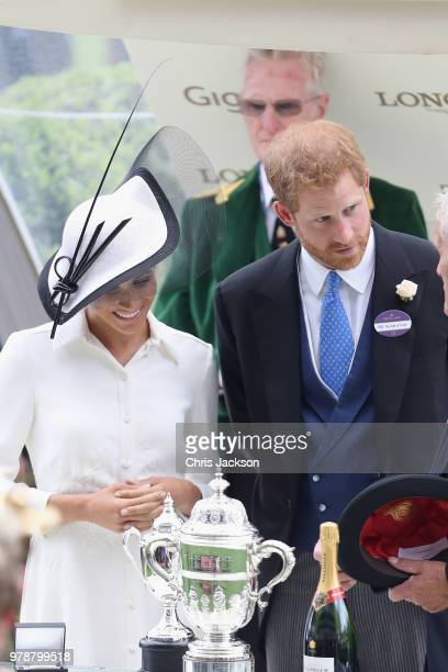 Meghan Duchess of Sussex and Prince Harry Duke of Sussex attend the prize ceremony of Royal Ascot Day 1 at Ascot Racecourse on June 19 2018 in Ascot...