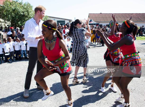 Meghan, Duchess of Sussex and Prince Harry, Duke of Sussex dance during a visit to The Justice Desk on September 30, 2019 in Cape Town, South Africa....