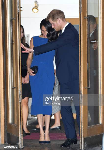 Meghan Duchess of Sussex and Prince Harry Duke of Sussex depart after attending the '100 Days To Peace' concert to commemorate the centenary of the...
