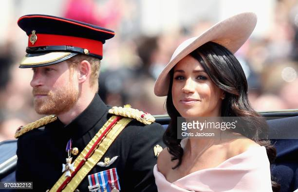 Meghan Duchess of Sussex and Prince Harry Duke of Sussex during Trooping The Colour on the Mall on June 9 2018 in London England The annual ceremony...