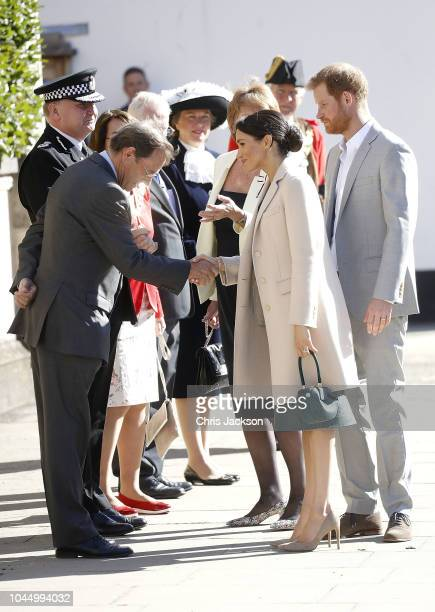 Meghan Duchess of Sussex and Prince Harry Duke of Sussex greet locals during an official visit to Sussex on October 3 2018 in Chichester United...