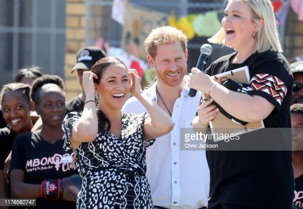Meghan, Duchess of Sussex and Prince Harry, Duke of Sussex laugh as Jessica Dewhurst, Justice Desk Founder makes a joke as they visit a Justice Desk...