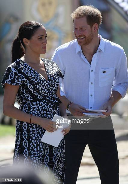 Meghan, Duchess of Sussex and Prince Harry, Duke of Sussex laugh during a visit to The Justice Desk on September 30, 2019 in Cape Town, South Africa....