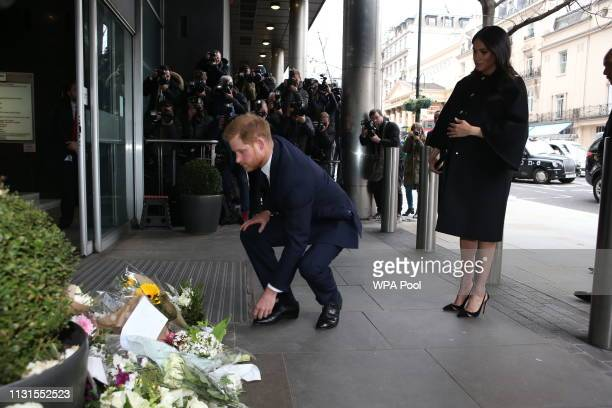Meghan Duchess of Sussex and Prince Harry Duke of Sussex lay floral tributes at New Zealand House on March 19 2019 in London England The visit was...