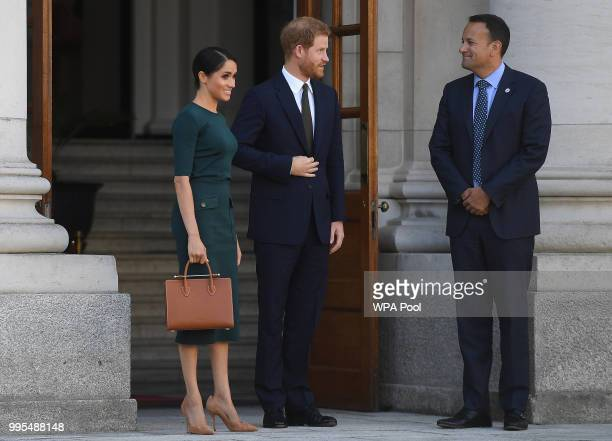 Meghan Duchess of Sussex and Prince Harry Duke of Sussex leave after visiting the Taoiseach of Ireland Leo Varadkar at the start of a twoday visit on...