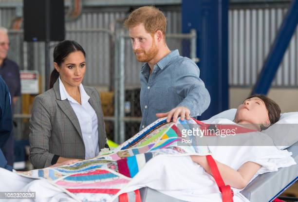 Meghan Duchess of Sussex and Prince Harry Duke of Sussex look at medical training equipment meant to simulate a pregnant patient during a naming and...
