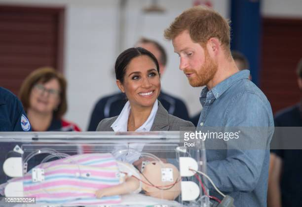 Meghan Duchess of Sussex and Prince Harry Duke of Sussex look at medical training equipment during a naming and unveiling ceremony for the new Royal...
