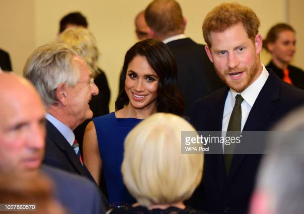 Meghan Duchess of Sussex and Prince Harry Duke of Sussex meet guests during interval of the '100 days of peace' concert to commemorate the centenary...