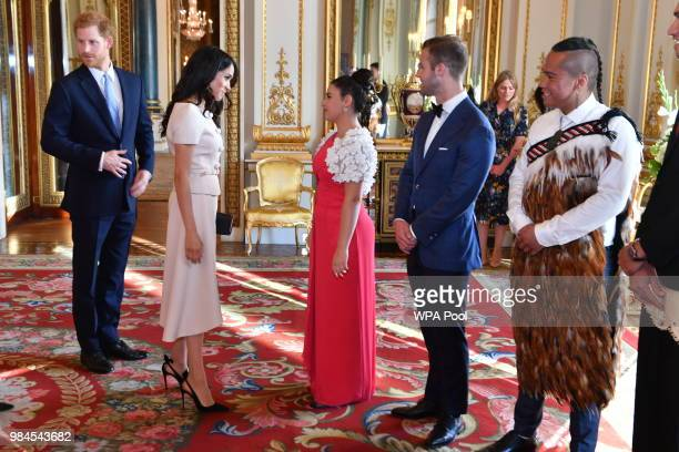 Meghan Duchess of Sussex and Prince Harry Duke of Sussex meet guests at the Queen's Young Leaders Awards Ceremony at Buckingham Palace on June 26...