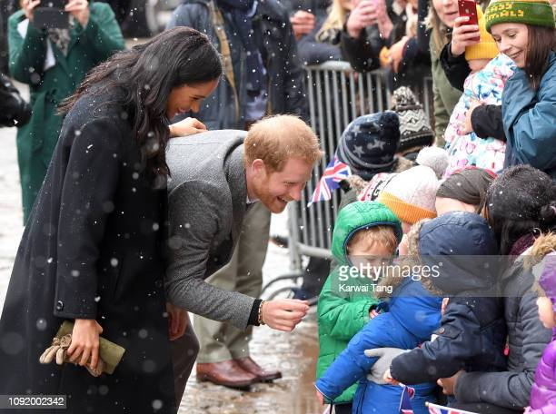 Meghan Duchess of Sussex and Prince Harry Duke of Sussex meet members of the public on a walkabout to the Bristol Old Vic on February 1 2019 in...